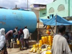 People queue in Harar with yellow jerry cans for water